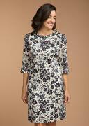 Vrouwelijk glanzende gedessineerde jurk
